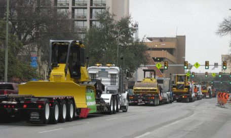 Parade of construction equipment down Commerce St.